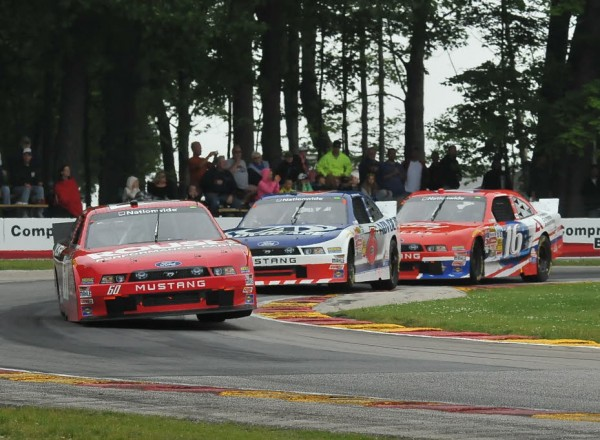 The Ford Mustang contingent of Chris Buescher, Trevor Bayne and Ryan Reed in turn six at Road America.  [John Wiedemann Photo]