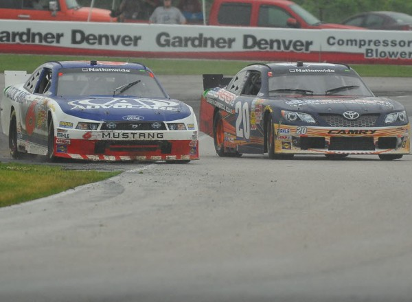 Trevor Bayne returns to the track after a turn 8 spin to battle Kenny Habul for position.  [John Wiedemann Photo]