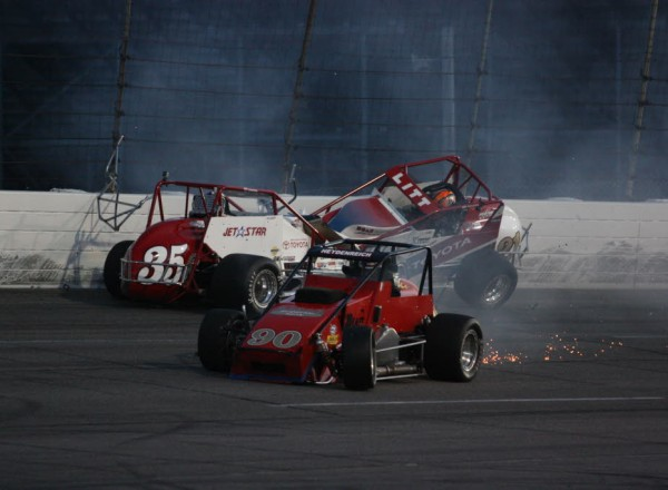 John Heydenreich (90) rolls away from the wreck with CJ Leary (35) and Ryan Litt (21).  [Mark Walczak Photo]