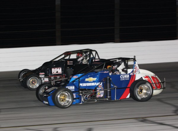 Ken Schraeder (10K)  races Chris Phillips (99) at Lucas Oil Raceway.  [Mark Walczak Photo]