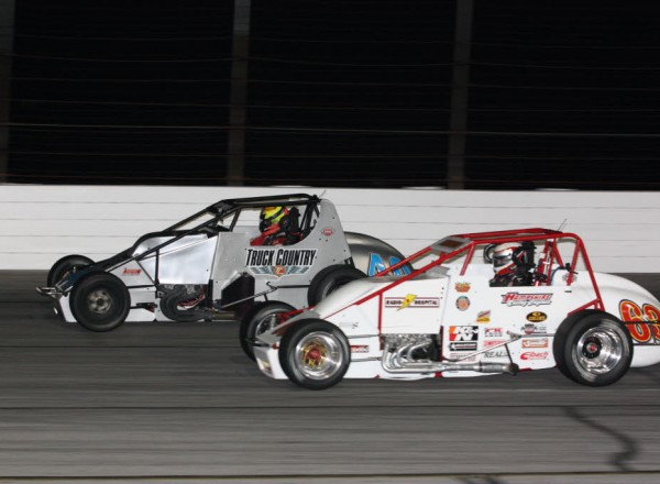 Kody Swanson (63) races to the inside of David Byrne (40) in a battle that lasted almost all 100 laps.  [Mark Walczak Photo]