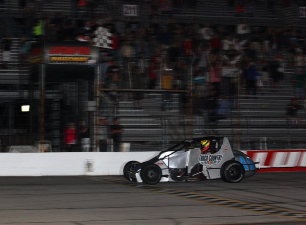 David Byrne takes the checkers and the win at Lucas Oil Raceway Indianapolis.  [Mark Walczak Photo]