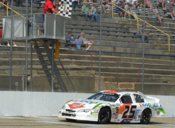 Justin Boston takes the checkers, winning the ARCA race at Madison International Speedway.  [Russ Lake Photo]