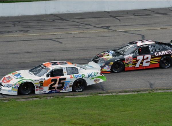 Justin Boston (25) races with Tom Hessert (72) at Madison International Speedway.  [Russ Lake Photo]