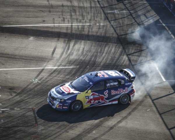 Travis Pastrana slides through a turn at The Port of Los Angeles.  [Credit Larry Chen / Red Bull Content Pool]