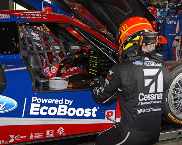 Kyle Larson in the car with McMurray providing guidance in foreground.  [Joe Jennings Photo]