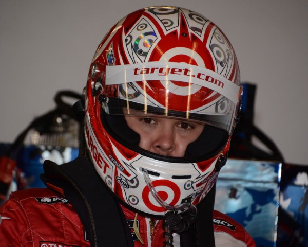Kyle Larson shown in helmet while practicing driver changes with teammates.  [Joe Jennings Photo]