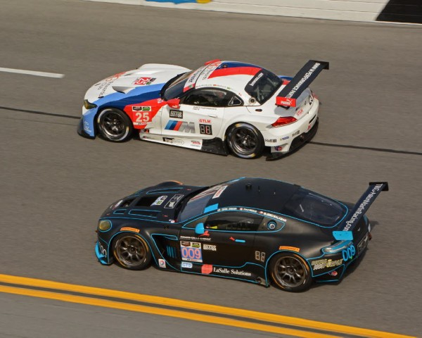 During practice, No. 25 BMW and No 009 Aston Martin shown in close action.  [Joe Jennings Photo]