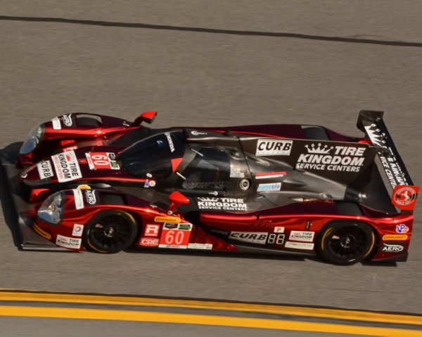 Michael Shank Racing pole winning car shown racing through the high-banked fourth turn.  [Joe Jennings Photo]