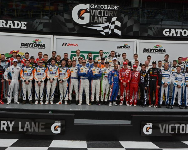48 championship drivers gather in victory lane for annual photo-shoot.  [Joe Jennings Photo]