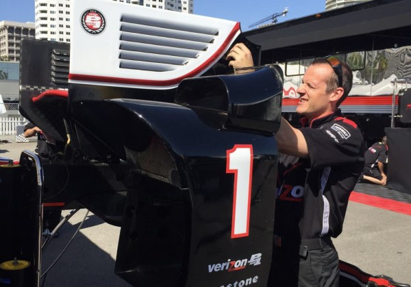 Will Power's mechanic works on a spare rear wing for the Team Penske driver.  [Eddie LePine Photo]