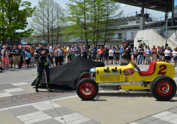 "This years Indy 500 ride sits covered next to Floyd ""Pop Dreyer's championship winning car.   [John Wiedemann Photo]"