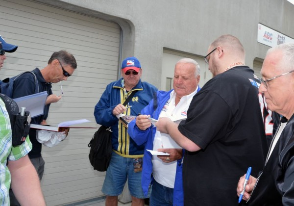 A.J. Foyt signs autographs at the Indianapolis Motor Speedway.  [Russ Lake Photo]