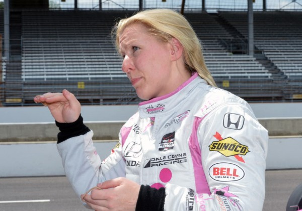 Pippa Mann discusses her car's handling at Indianapolis Motor Speedway.  [Russ Lake Photo]