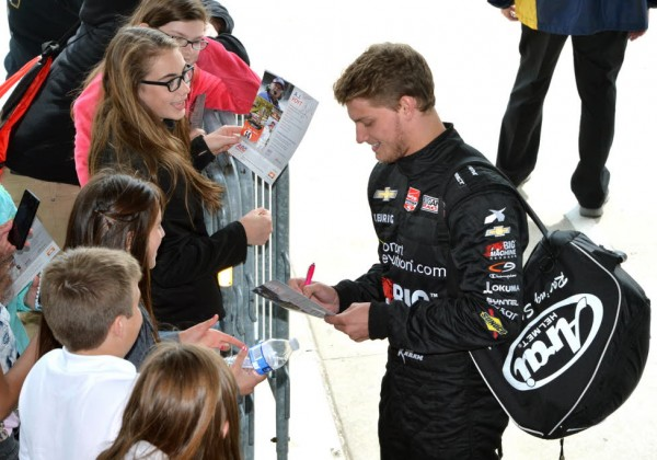 Sage Karam signs autographs for his fans.  [Russ Lake Photo]