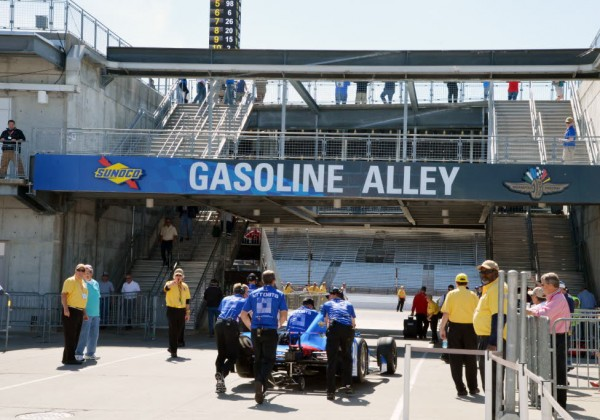 Teams push their cars through Gasoline Alley at Indy to prepare for practice on the Speedway.  [Russ Lake Photo]