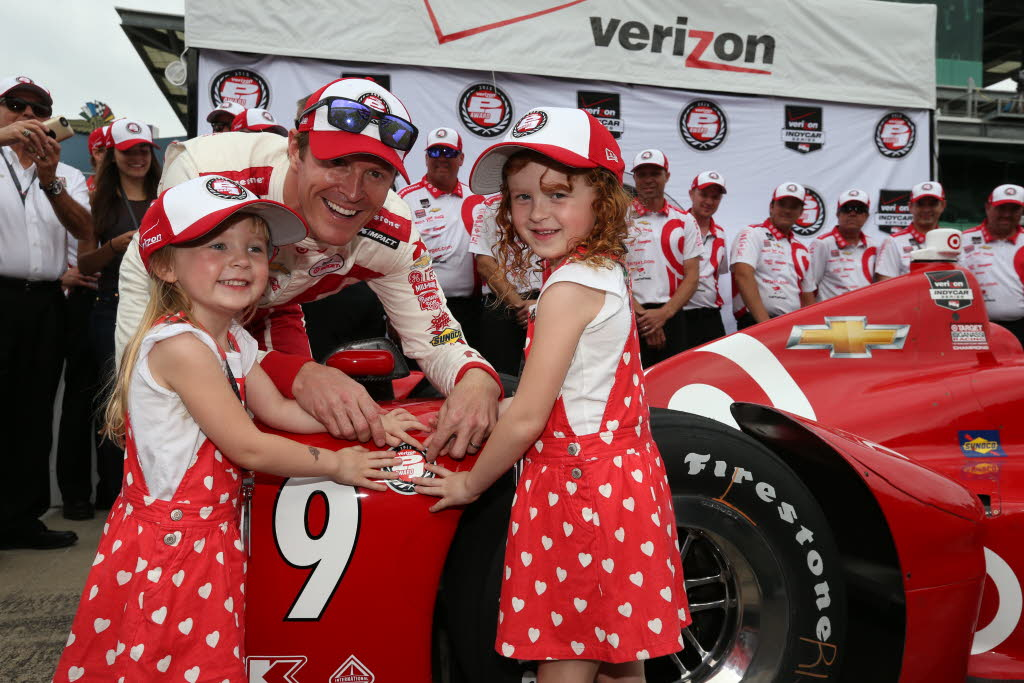 Scott Dixon and his daughters put the P1 sticker on his car after he won the pole position for the 2015 Indianapolis 500. [Chris Jones Photo]