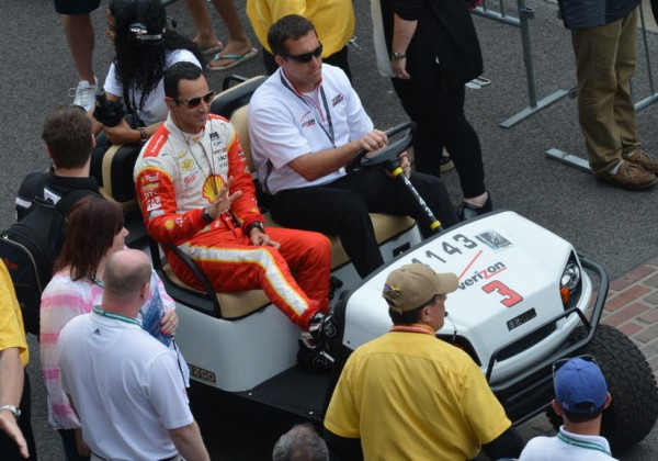 Helio Castroneves waves to fans on his way to his car.  [Russ Lake Photo]