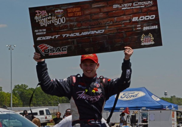 """Day before the 500"" winner Tanner Swanson holds up winning check.  [Joe Jennings Photo]"