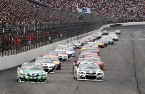 Kyle Busch and Jimmie Johnson lead the field at the start of the 2014 Camping World RV Sales 301 at New Hampshire Motor Speedway. [Credit: Jeff Zelevansky/NASCAR via Getty Images]