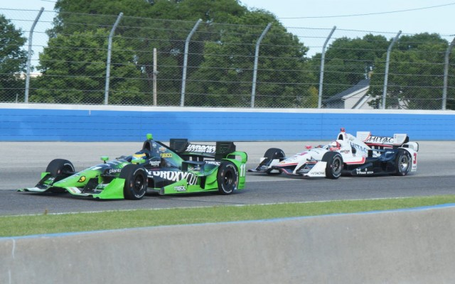 Sebastien Bourdais leads Helio Castroneves during the ABC Supply Co. Wisconsin 250.  [Russ Lake Photo]