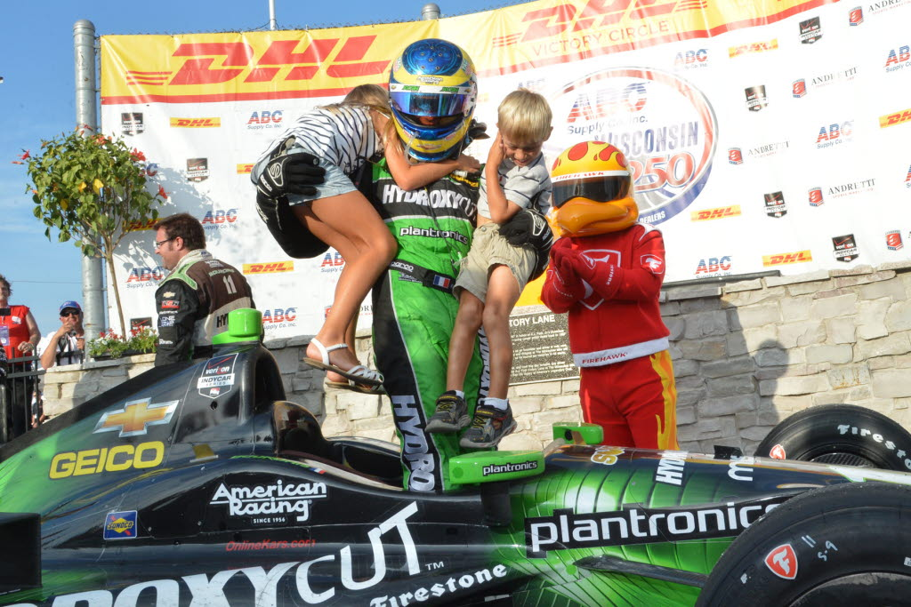 Sebastien Bourdais celebrates with his kids in victory lane at the Milwaukee Mile. [Russ Lake Photo]