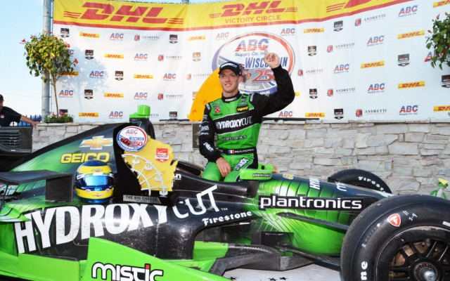 Sebastien Bourdais in victory lane at the Milwaukee Mile after winning the ABC Supply Co. Wisconsin 250.  [Russ Lake Photo]