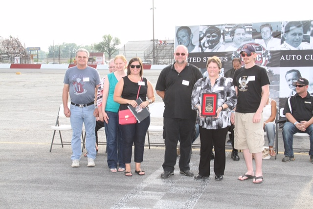 Family of Jim Hurtubise accepts USAC HoF plaque.  [John Mahoney Photo]