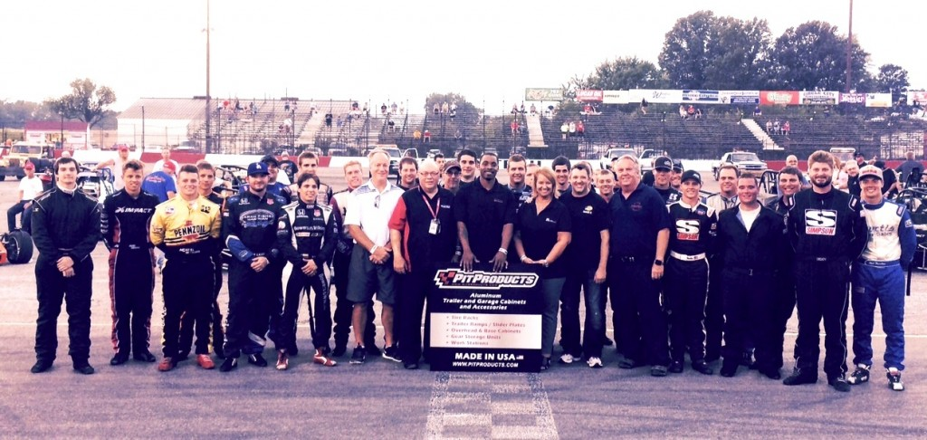 Tony Stewart and promoter, Larry Curry poses with the starting field of the first annual Tony Stewart Classic Saturday evening.   [Photo by Steve Zautke]