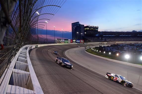 NASCAR Sprint Cup Series drivers race into the night under the lights at Texas Motor Speedway in Fort Worth, Texas. [Credit: Jared C. Tilton/NASCAR via Getty Images]