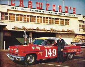 Crawford poses in front of the Crawford's Grocery store with his Pan American race winning Lincoln.  Photo courtesy of the author, Andrew Layton