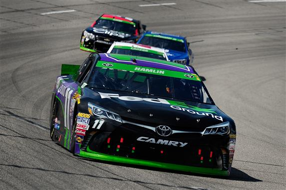Denny Hamlin leads a pack of cars during the 2015 NASCAR Sprint Cup Series Toyota Owners 400 at Richmond International Raceway. [Credit: Jeff Curry/Getty Images]