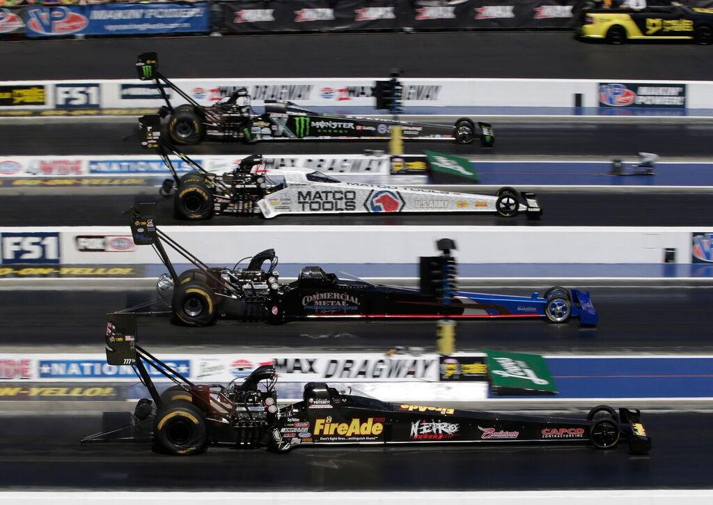 Brittany Force (top lane) drives to the win at the NHRA 4-Wide Nationals presented by Lowes Foods at zMAX Dragway. (CMS/HHP photo)