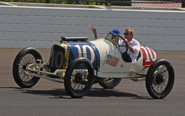 Arie Luyendyk drives old Duesenberg in parade.  [Joe Jennings Photo]