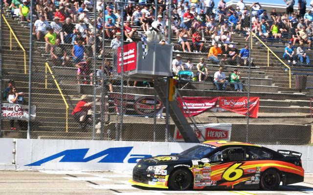 Josh Williams races under the checkered flag to capture his 2nd career ARCA Series victory.  [Russ Lake Photo]