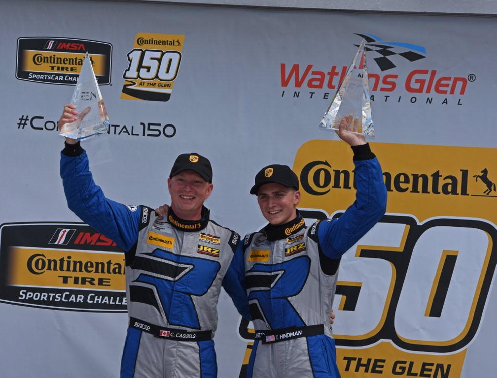 GT class victors Cameron Cassels and Trent Hindman hoist their winning hardware. [Joe Jennings Photo]