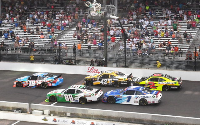 Green-white-checkers restart with Kyle Busch in the lead.  [Russ Lake Photo]