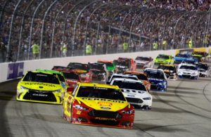 Joey Logano leads the field past the green flag to start the NASCAR Sprint Cup Series Federated Auto Parts 400 at Richmond International Raceway on September 12, 2015. [Credit: Robert Laberge/NASCAR via Getty Images]