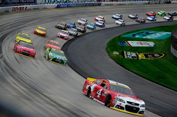 Kevin Harvick leads a pack of cars during the NASCAR Sprint Cup Series AAA 400 at Dover International Speedway. [Credit: Jeff Curry/Getty Images]