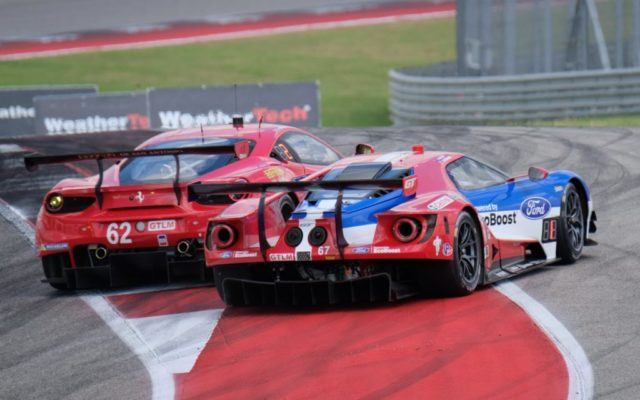 Ferrari/Ford shoving match at the start.  [Photo by Jack Webster]