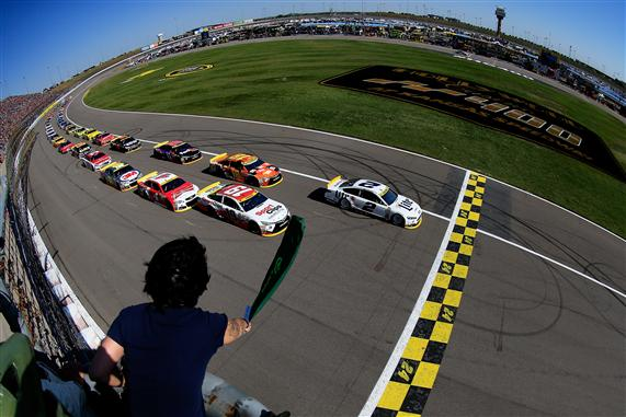 Brad Keselowski and Carl Edwards lead the field to the green flag to start the NASCAR Sprint Cup Series Hollywood Casino 400. [Credit: Photo by Chris Trotman/NASCAR via Getty Images]