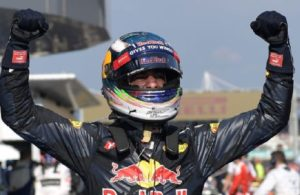 Red Bull's Daniel Ricciardo celebrates hi win in the Grand Prix of Malaysia. [Photo courtesy of Mohd Rasfan of AFP/Getty Images]