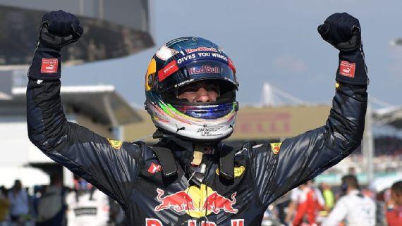 Red Bull's Daniel Ricciardo celebrates hi win in the Grand Prix of Malaysia. [Photo courtesy of Mohd Rasfan of AFP/Getty Images]