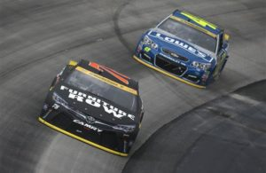 Martin Truex Jr. races Jimmie Johnson during the NASCAR Sprint Cup Series Citizen Solider 400 at Dover International Speedway. [Credit: Sean Gardner/NASCAR via Getty Images]