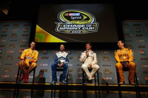 (L-R) Joey Logano, Jimmie Johnson, Carl Edwards and Kyle Busch talk to the media about the NASCAR Sprint Cup Series Championship. [Photo by Chris Trotman/Getty Images]