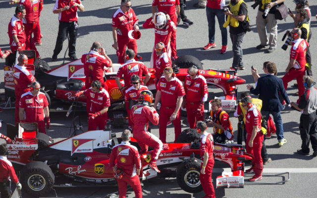 Sebastian Vettel and Kimi Raikkonen get ready to head out on the Daytona International Speedway.  [Photo by Thomas Murray]