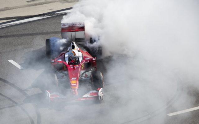 Sebastian Vettel making donuts at the Daytona International Speedway.  [Photo by Thomas Murray]