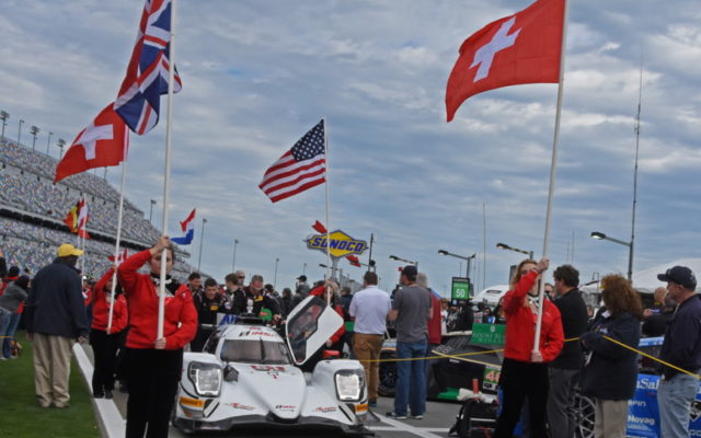 National flags fly high as first of Prototypes rolls along the ropes.  [Joe Jennings Photo]