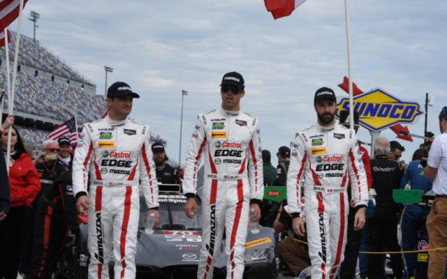 James Hinchcliffe and co-drivers Joel Miller and Tom Long walk in front of their Mazda.  [Joe Jennings Photo]