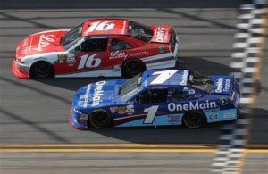 Ryan Reed races Elliott Sadler during the NASCAR XFINITY Series PowerShares QQQ 300 at Daytona International Speedway. [Credit: Chris Graythen/Getty Images]